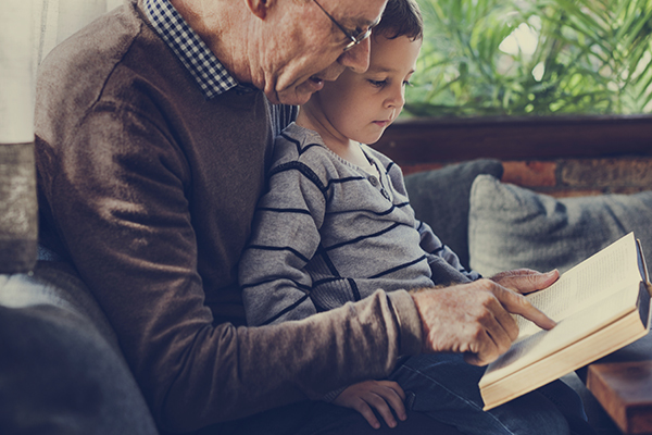 Grandfather and grandson reading 600x400