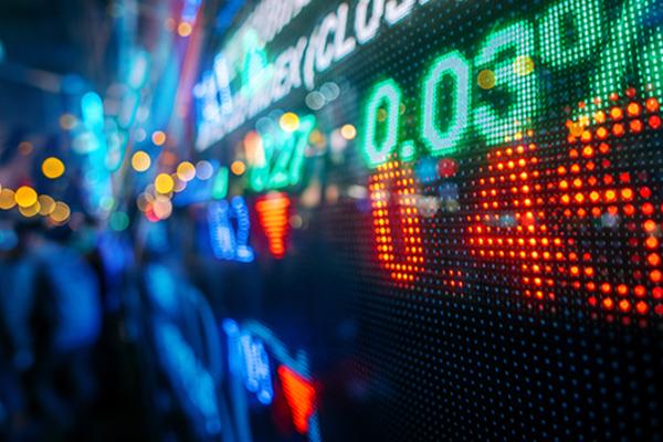 Neon stock market numbers blurred 600x400
